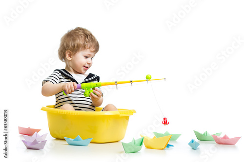 Kid boy plays fishing