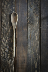 Wooden kitchenware on gbrown background