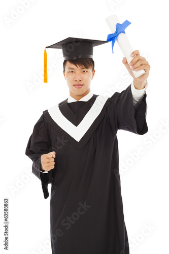 happy graduating student holding diploma