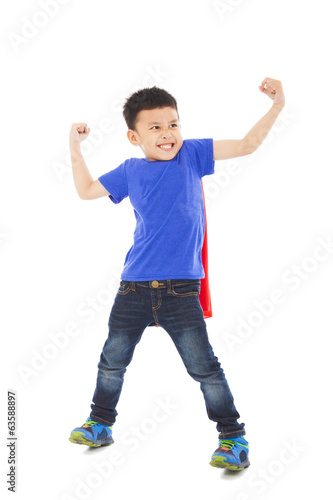 happy super kid hero imitate superman pose