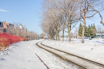Curving Railway Track Covered in Snow
