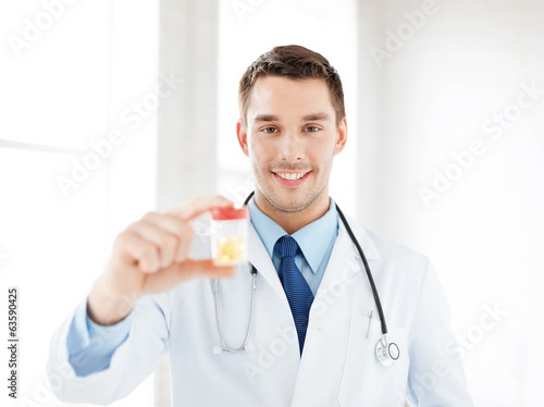 male doctor with jar of capsules