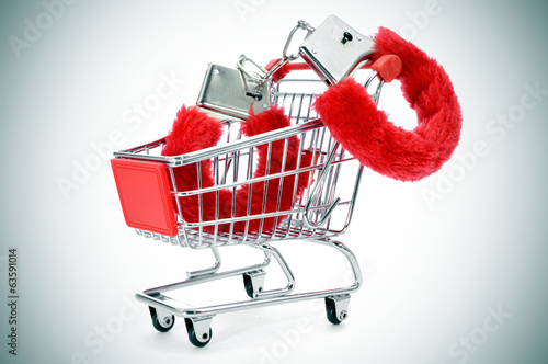 sexy fluffy handcuffs in a shopping kart