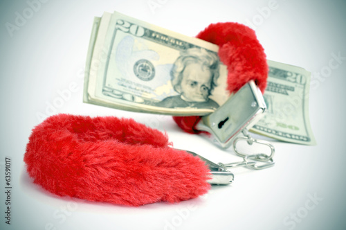 sexy fluffy handcuffs and dollar bills