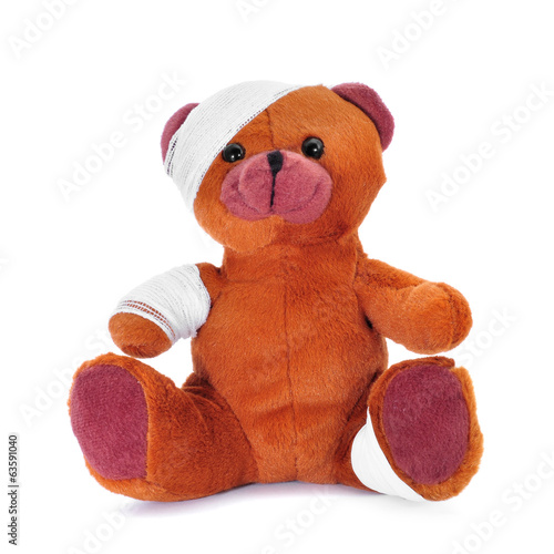 teddy bear with bandages in its head, arm and leg