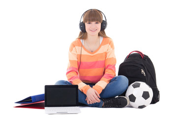 sitting teenage girl listening music in headphones isolated on w
