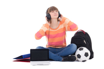 teenage girl in headphones sitting with laptop isolated on white