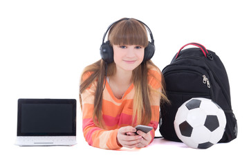 teenage girl in headphones with laptop and phone isolated on whi