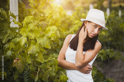 young beautiful girl posing in fall vineyard