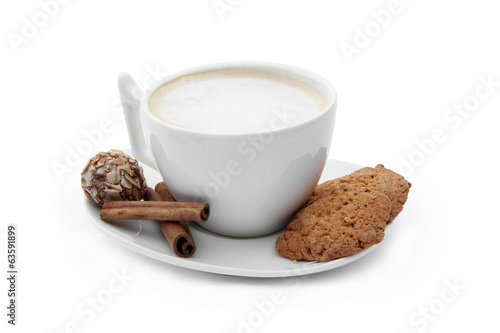 cup of coffee with chocolate candy, cookies and cinnamons