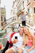 Travel couple in Venice on Gondole ride romance