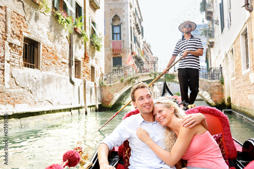 Romantic travel couple in Venice on Gondole boat