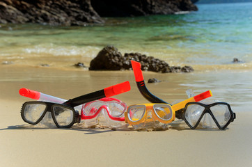 Snorkels on tropical beach sand