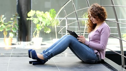 Girl surfing the Internet using her tablet PC (PAL)