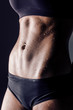 closeup studio shot fitness woman abs
