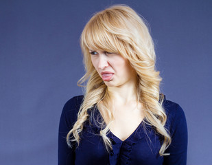 Disgusted woman with bad taste in mouth