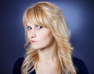 Skepticism. Suspicious unhappy young woman