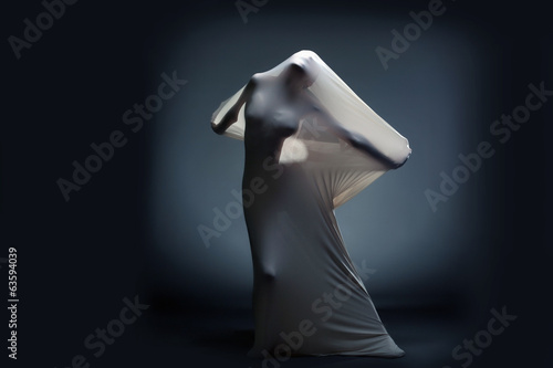 Studio shot of screaming naked female silhouette