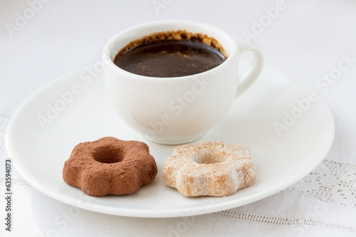 Cup of coffee and some cookies