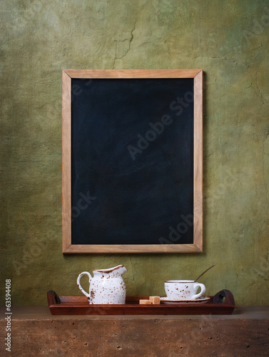 Cup and chalk board menu