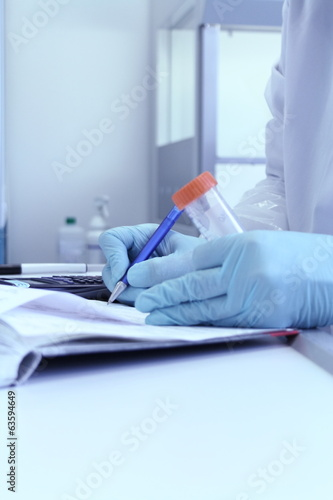 Laboratory Technician write test results from lab