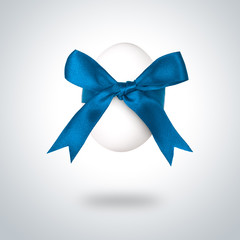 Easter egg with blue bow