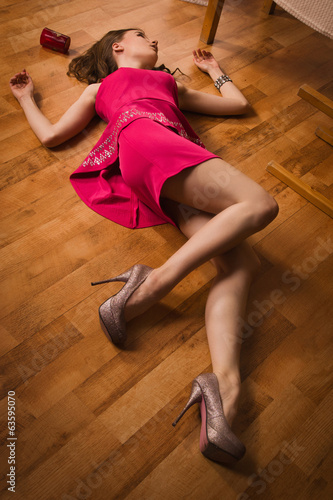 Lifeless woman in a luxurious interior