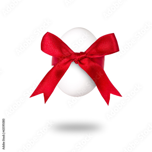 Easter egg with red bow. On white background.