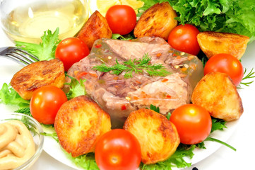 Aspic from meat with roasted potatoes and fresh vegetables
