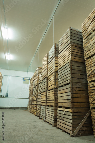 view on row of crate with potato in storage house