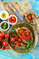 Bruschetta with fresh cherry tomatoes and herb pesto