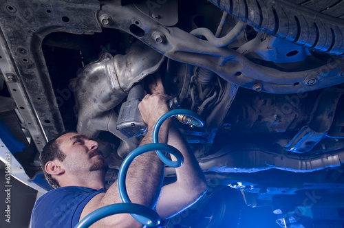 Mechanic with Air Spanner