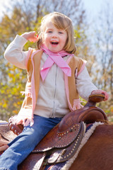 Little Cowgirl riding a horse