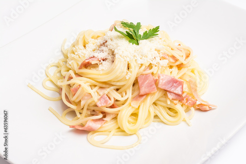 Spaghetti Carbonara With Baked Ham And Parmesan Close Up