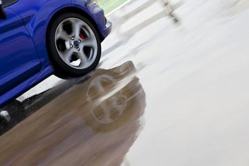 Wet asphalt.