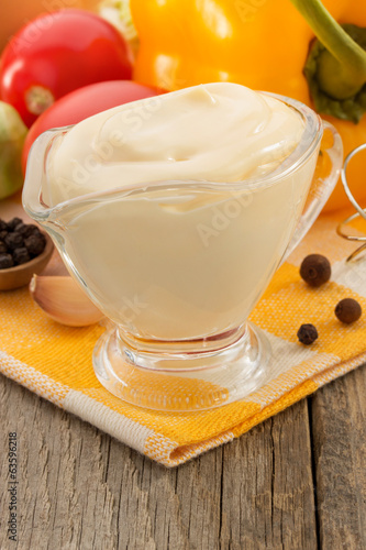 mayonnaise sauce in bowl on wood