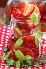 Strawberry tea. Refreshing summer ice tea with fruits and herbs
