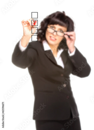 Cheerful senior business woman with pen drawing on virtual white