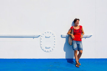 girl smiling on a ferry to Sardinia