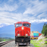 Freight train in Canadian rockies. - 63597463