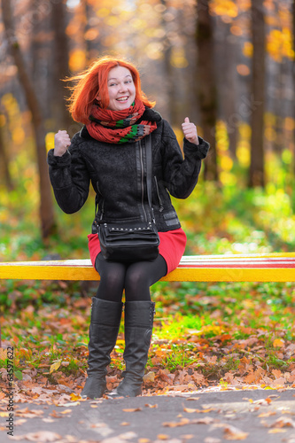 Portrait of beautiful laughing red-haired woman