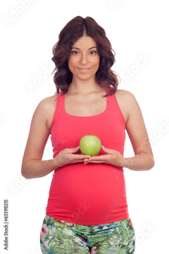 Beautiful pregnant woman with a apple