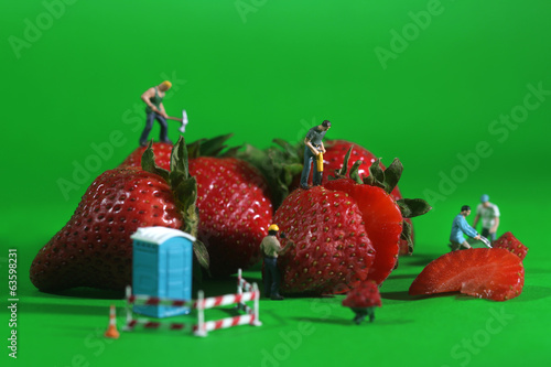 Construction Workers in Conceptual Food Imagery With Strawberrie
