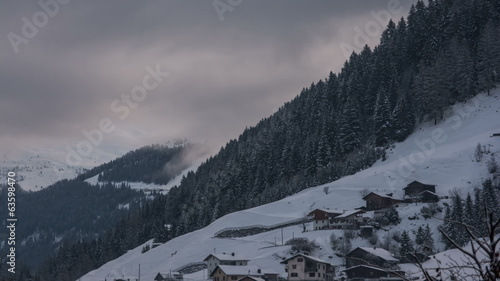 Tirol village of See dawn fog