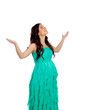 Beautiful pregnant woman with green dress