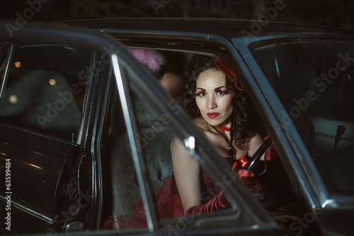 Young sexy woman sitting in car