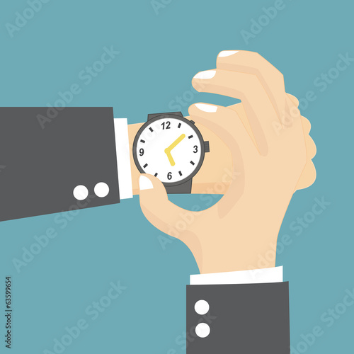 Businessman checking the time on his wrist watch
