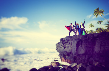 Business superheroes edge of cliff