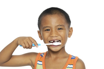 little boy brushing teeth, isolated on white
