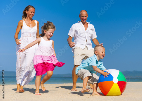 Family playing Ball on Beach